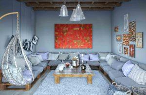 """Bild """"Abendrot"""" im Interieur eines Wohnraumes über die langen Couch."""